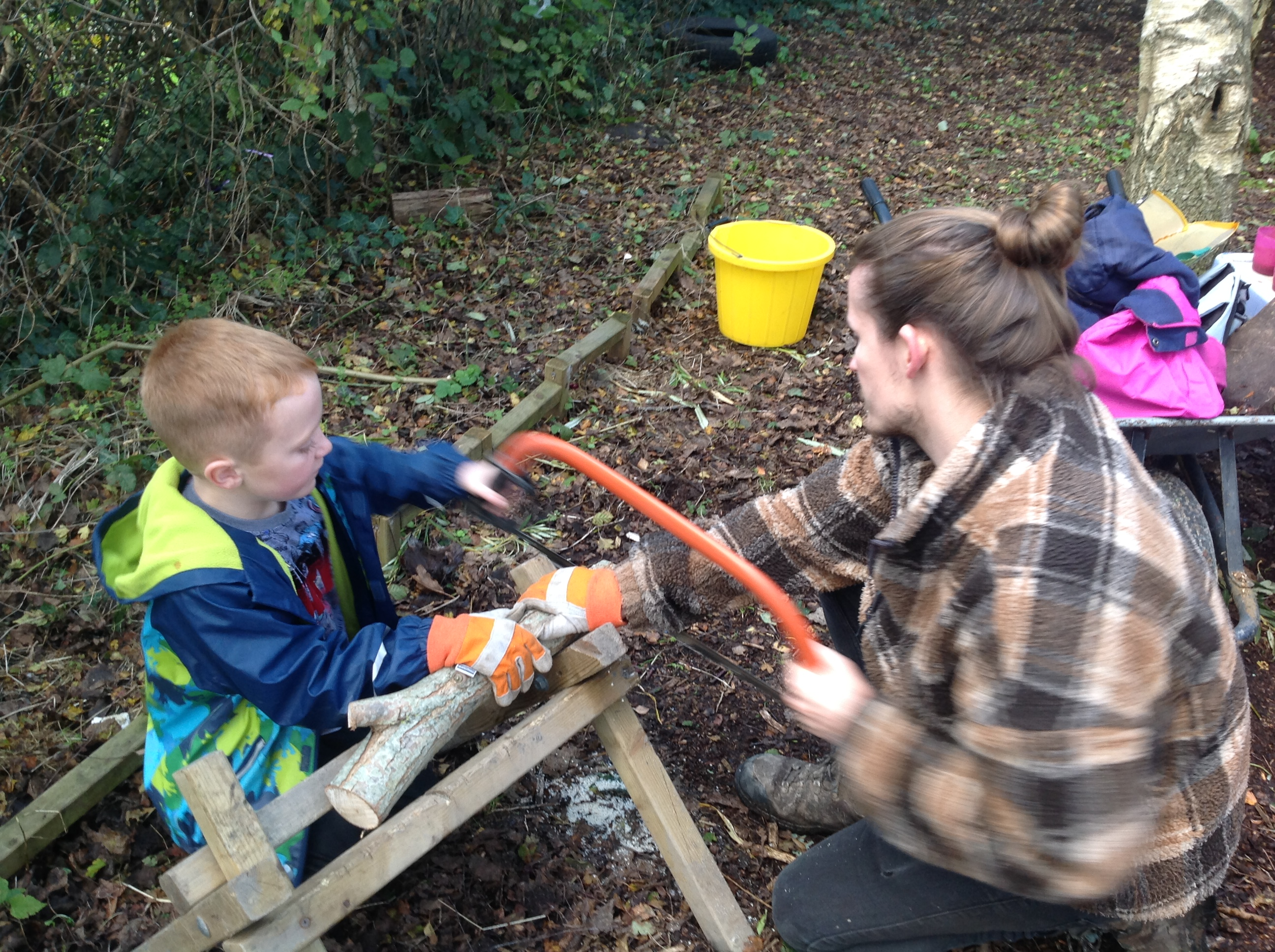 A child is learning to use tools safely.