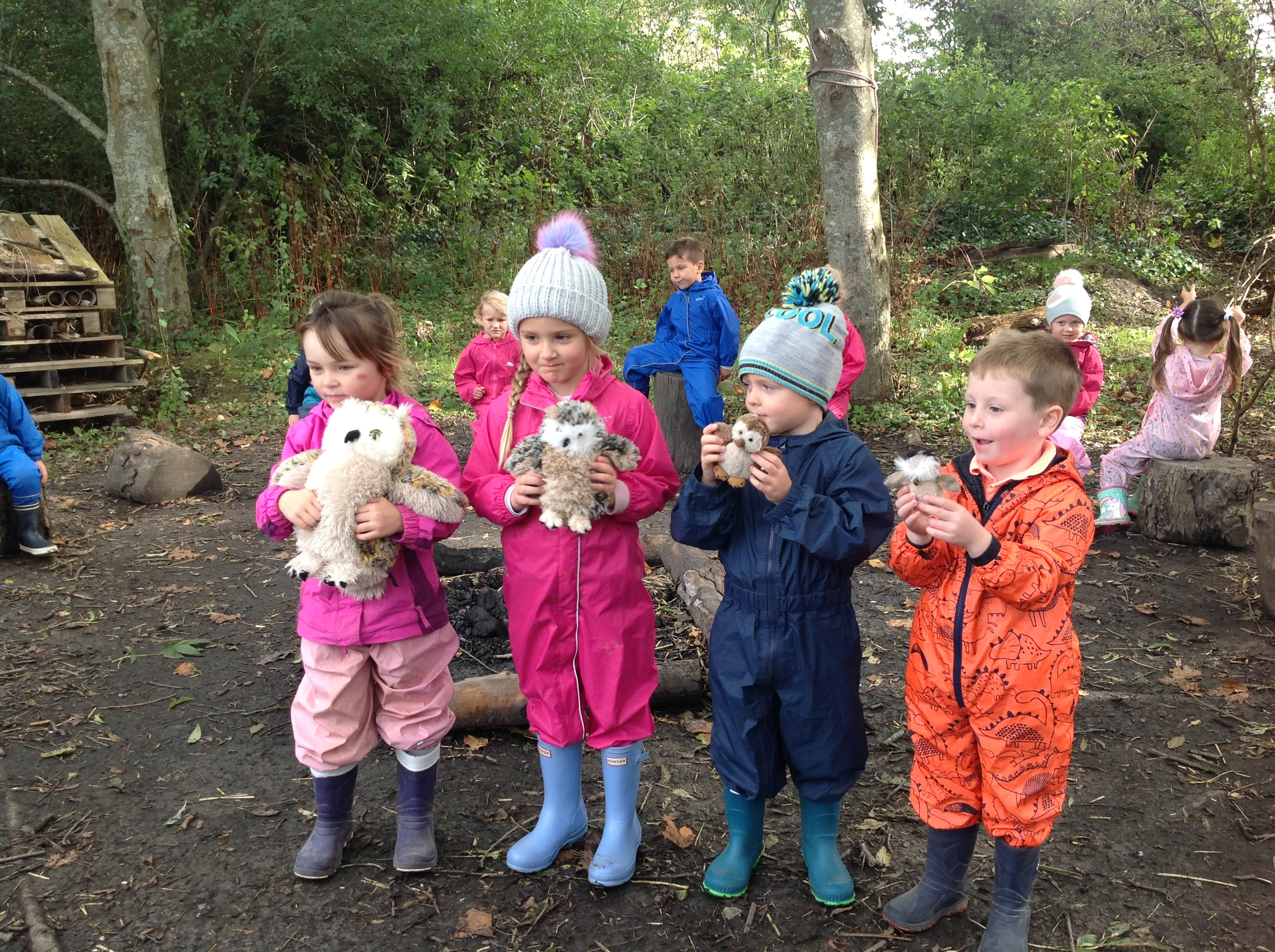 Children holding their owl toys.