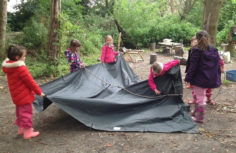 Children working together to make a shelter