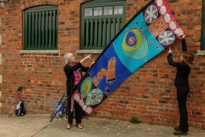 Marilyn Campbell talks about the flag she helped design at Woolsthorpe Manor.