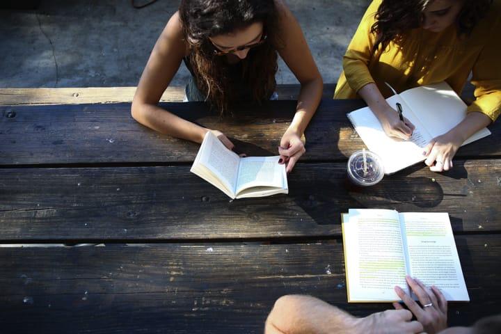 three-women-meeting-around-table