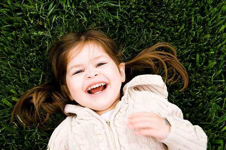 girl-in-grass-laughing-nz-ece