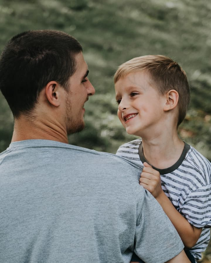 Dad looking his son in the eyes