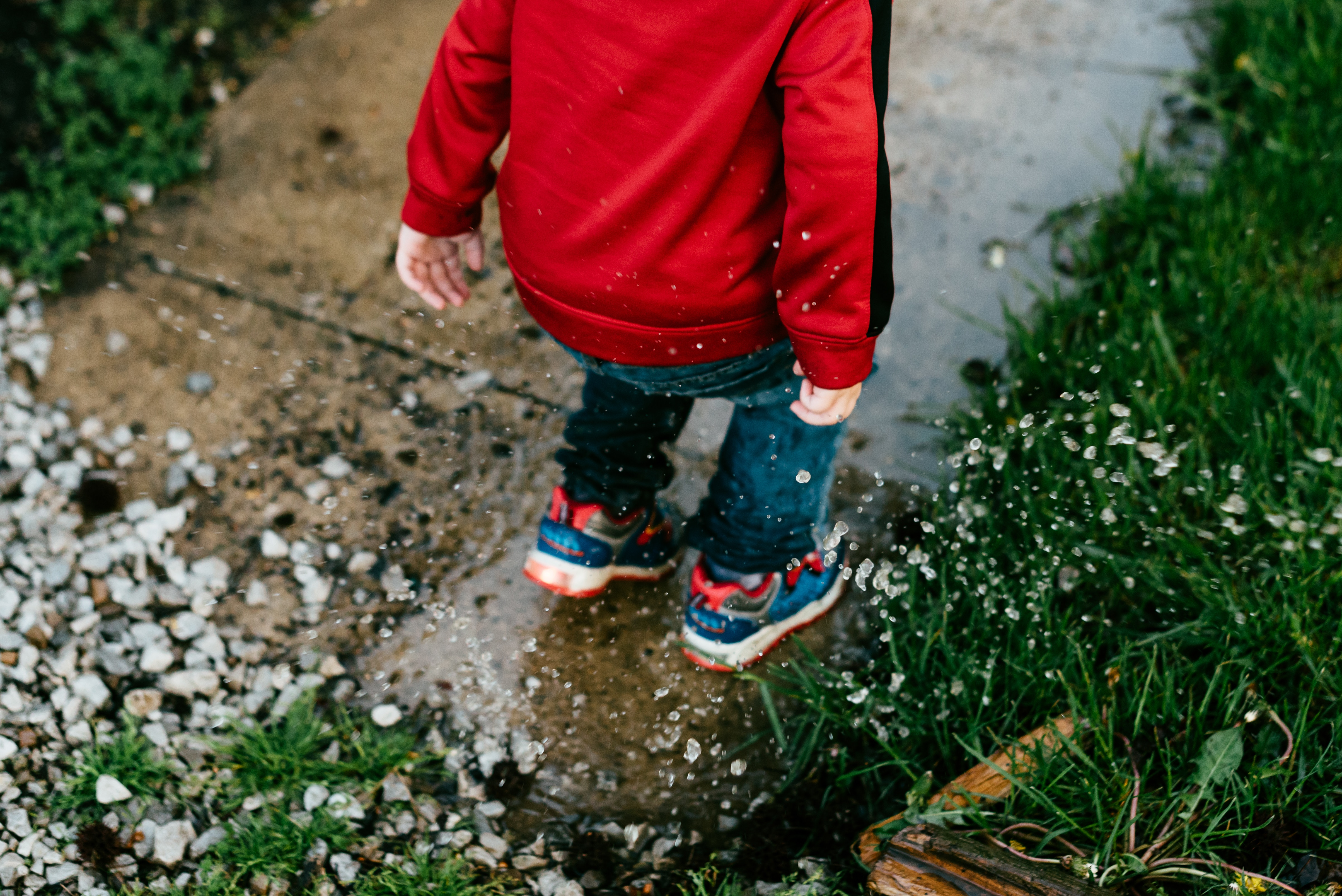 child-jumping-in-puddle-ece-nz