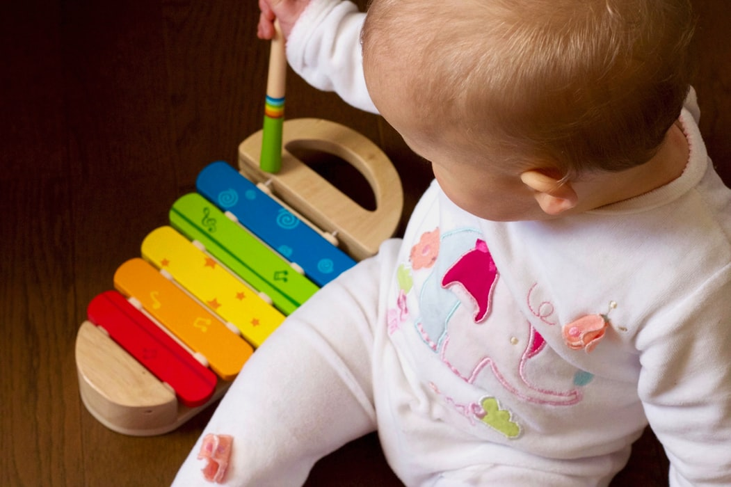 baby-with-musical-instrument