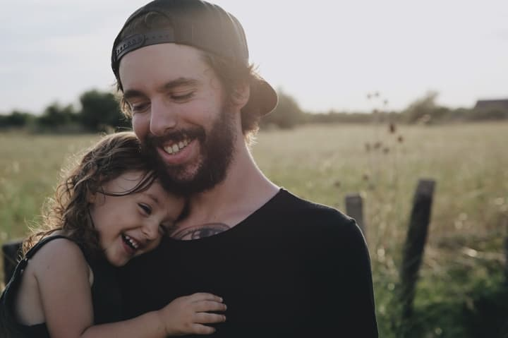Dad with his daughter on his chest