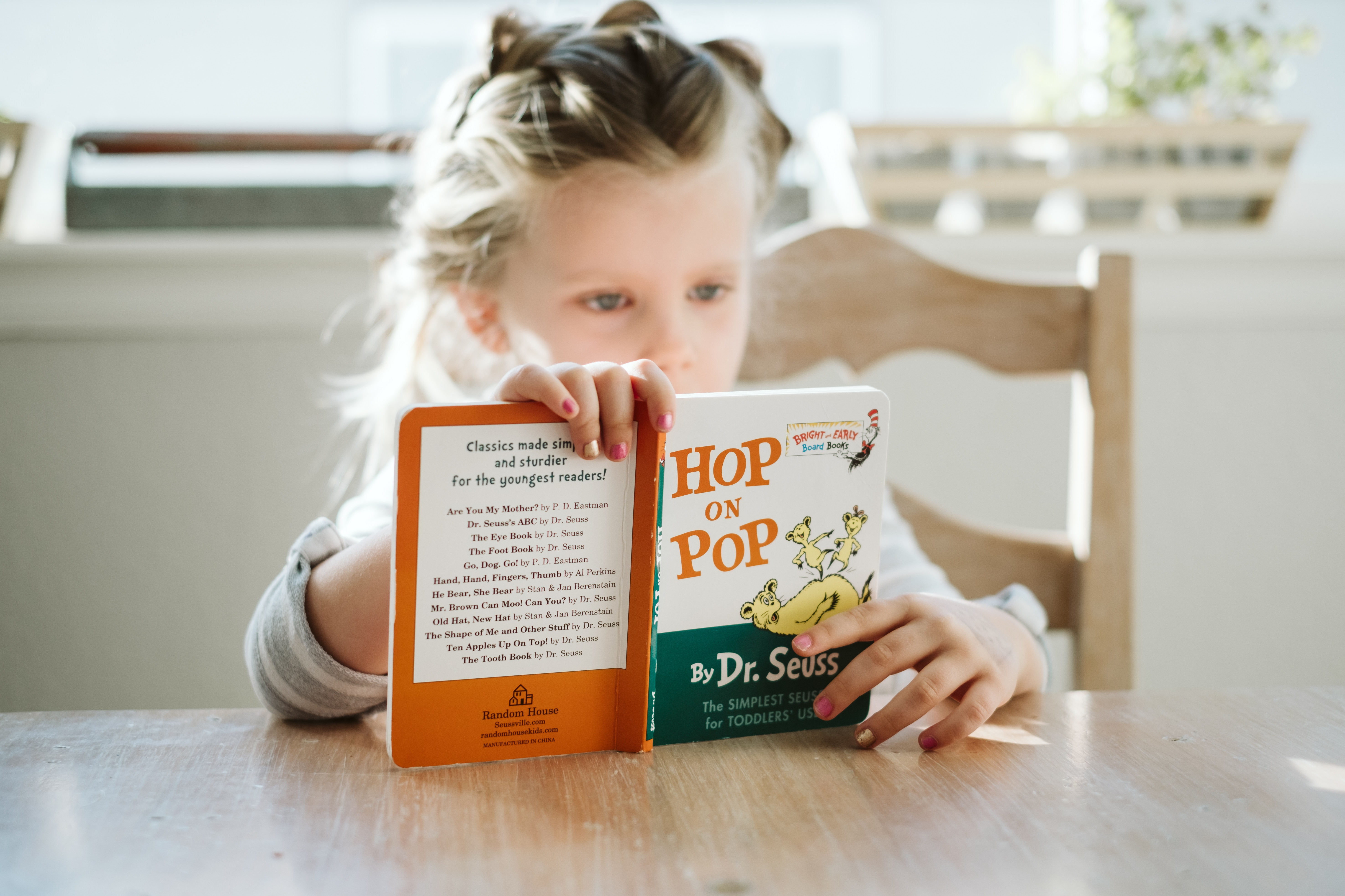 nz-ece-child-reading-book