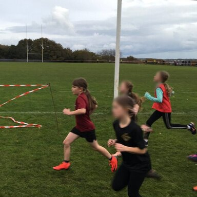 Girls running in the cross country event