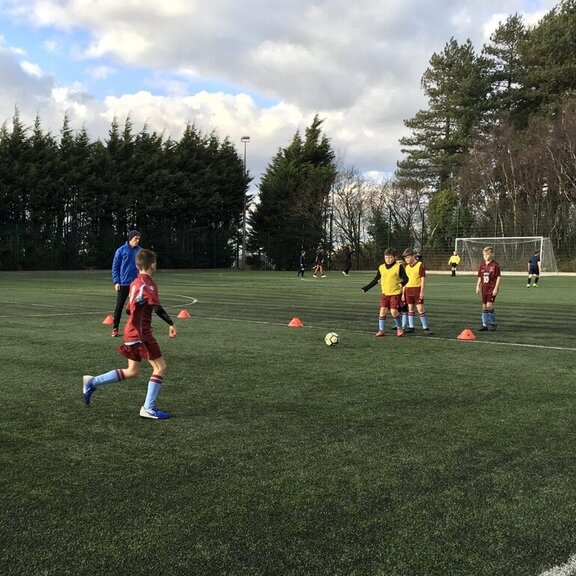 Training on the pitch with the coach