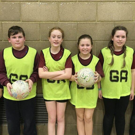 Sandown yellow team against a wall