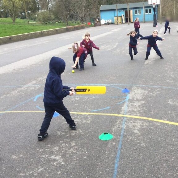 Playing cricket in the playground
