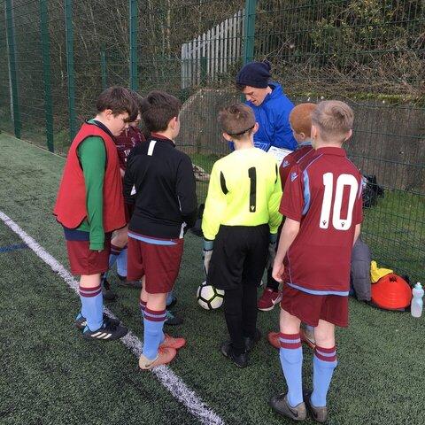 Coach giving a pre-match team talk