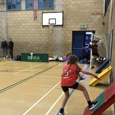 Children running on the court