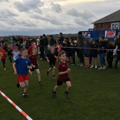 Boy running in the cross country