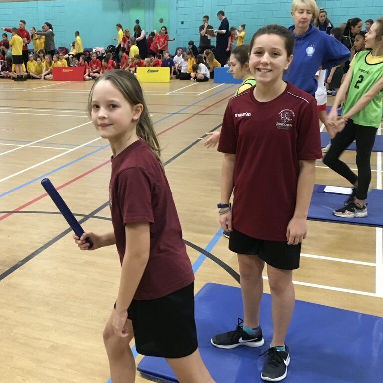 Two girls waiting to start a relay race