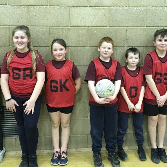 Sandown red team against a wall