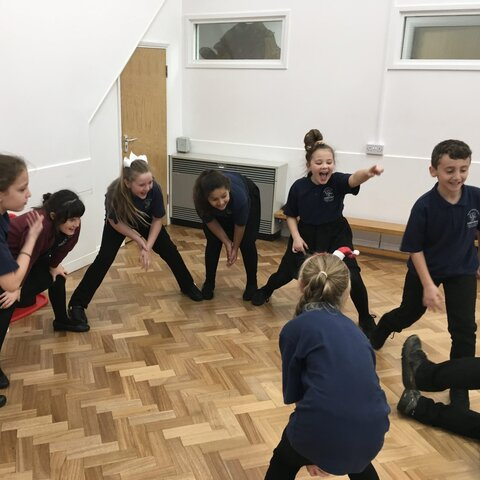 Sports leaders in a circle practising