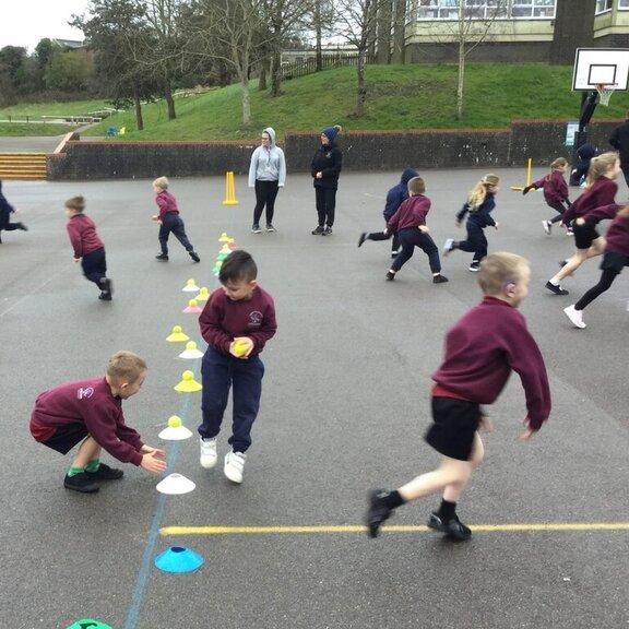 Children running between cones