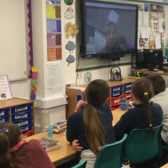 Children watching the video call.