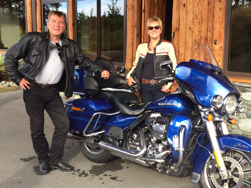 Paul and Gill - Milford Sound New Zealand by Harley Davidson