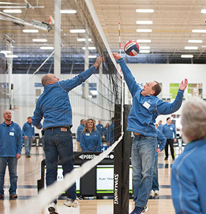 Charter employees playing volleyball