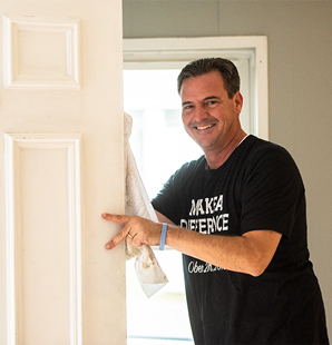 Man at Charter makes a difference day holding door