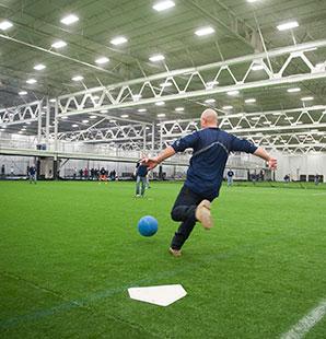 Charter employees playing kickball