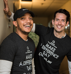 Men in make a difference day shirts