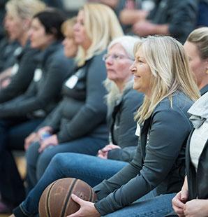 Charter employees watching basketball