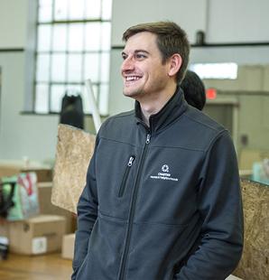 Man smiling inside building
