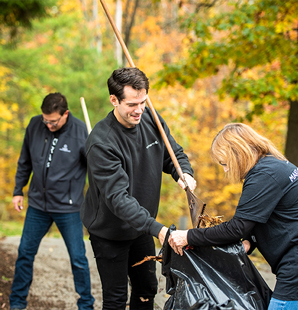 People at Charter makes a difference day raking leaves