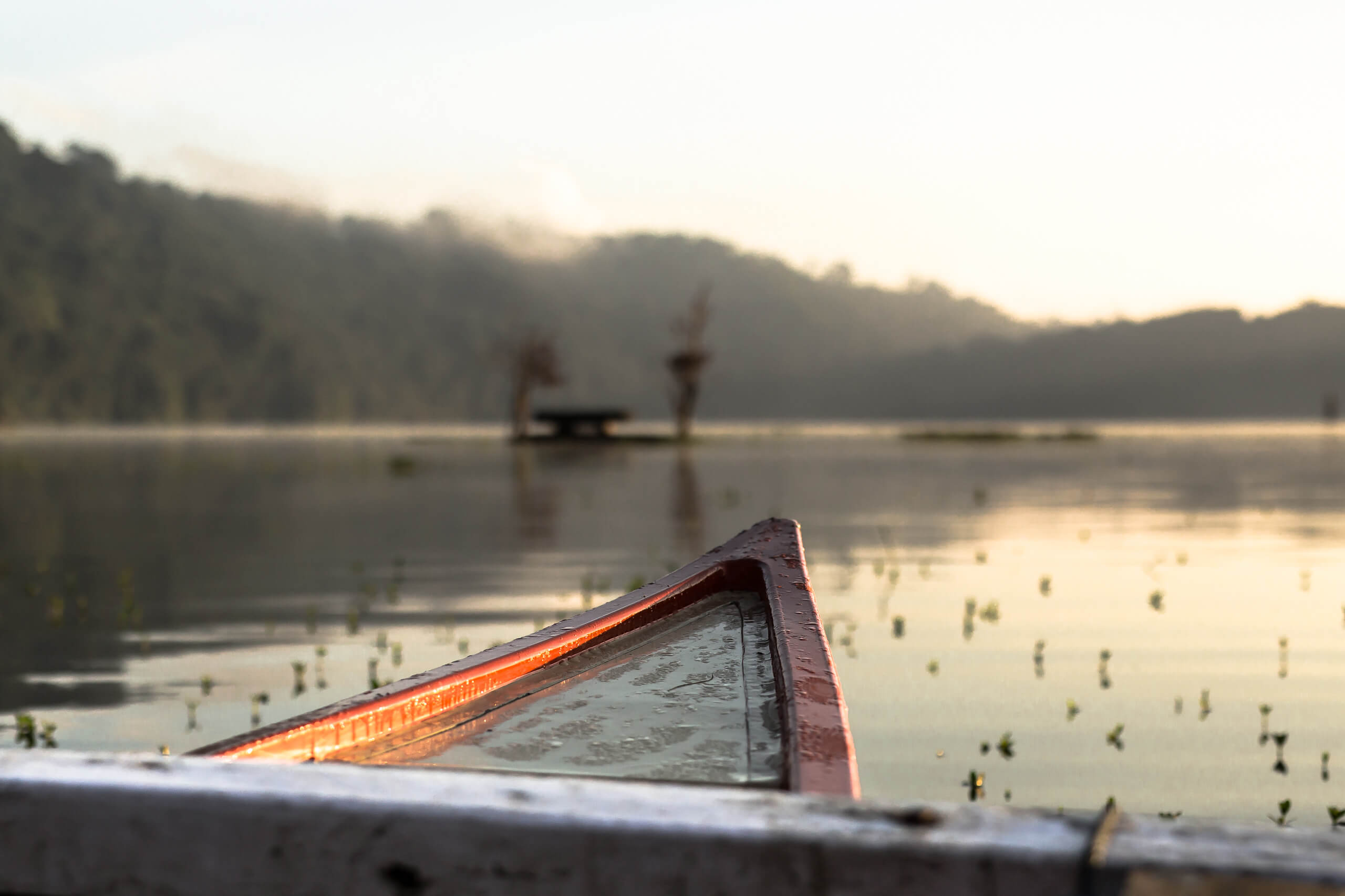 TAMBLINGAN LAKE TEMPLE | The leaky canoe was fun until our lovely local captain told us how deep the lake is!