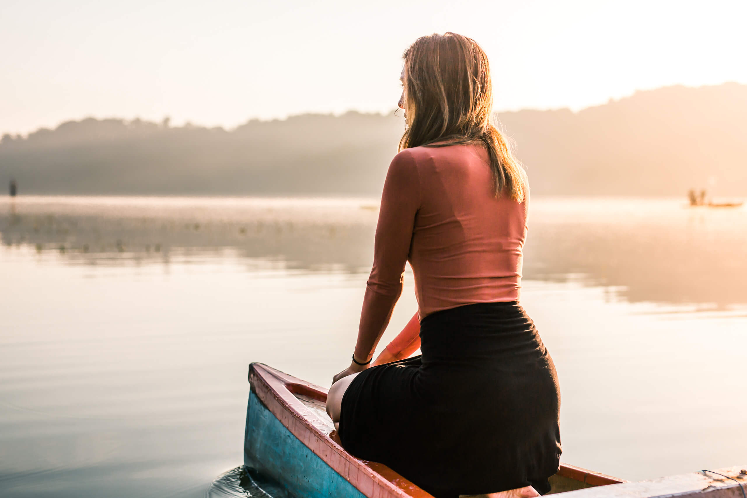 TAMBLINGAN LAKE TEMPLE | Capturing a moment of solitude on the bow of the canoe as the sun continued to grow.