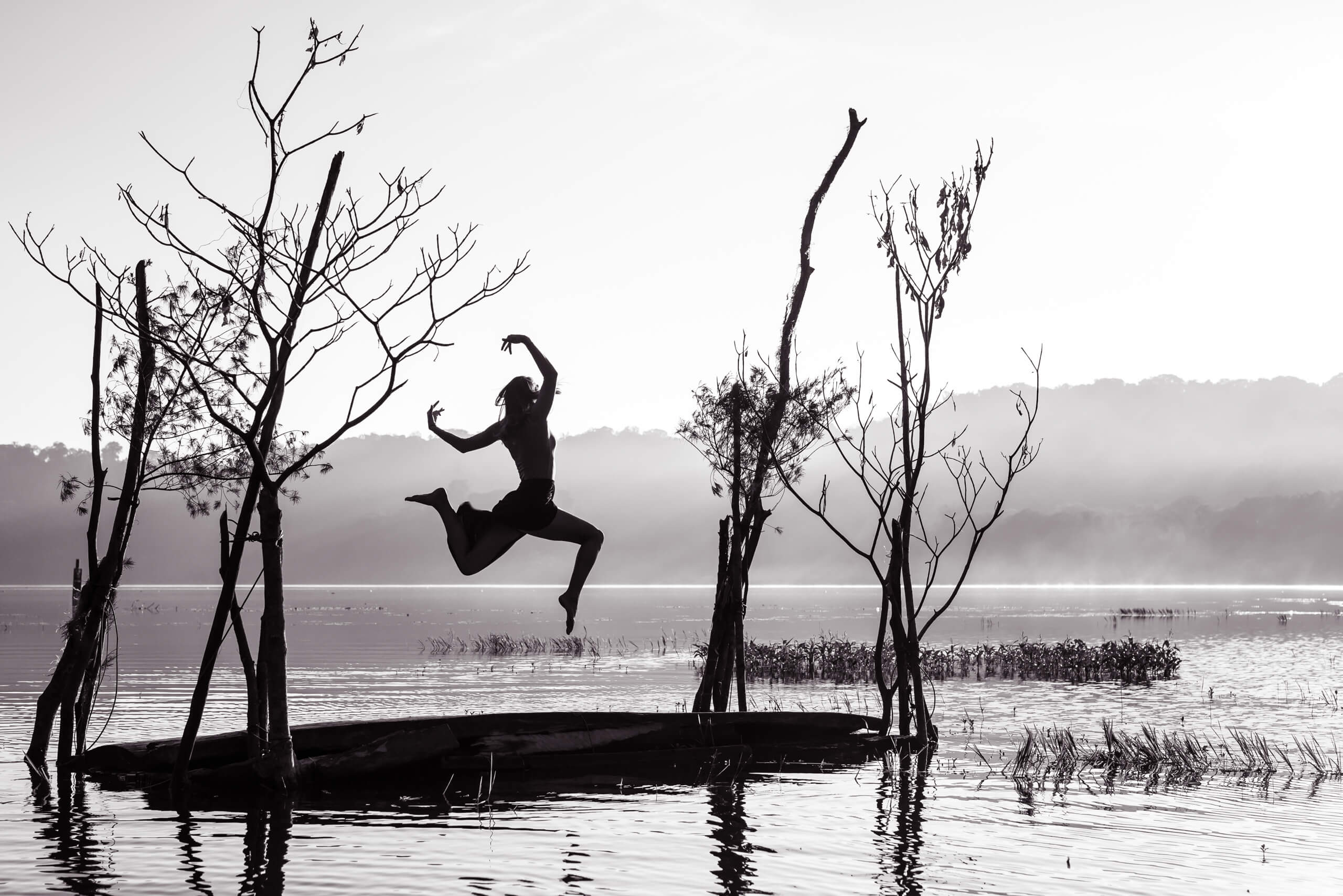 TAMBLINGAN LAKE TEMPLE   The small floating platform made of trees and planks had Sam jumping for joy.
