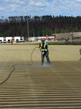Pressure cleaning warehouse roof