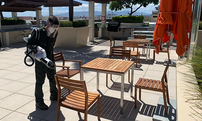Man disinfecting a hotel