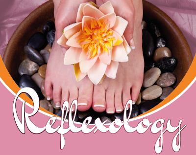 Reflexology - photograph of bare feet in bowl of pebbles and water
