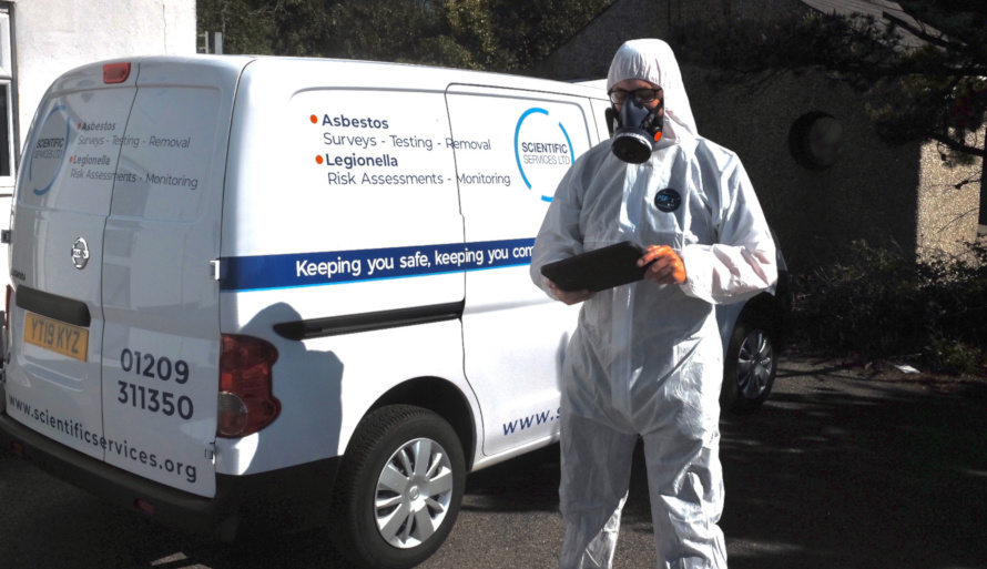 Surveyor with a tablet collecting a sample for anthrax testing