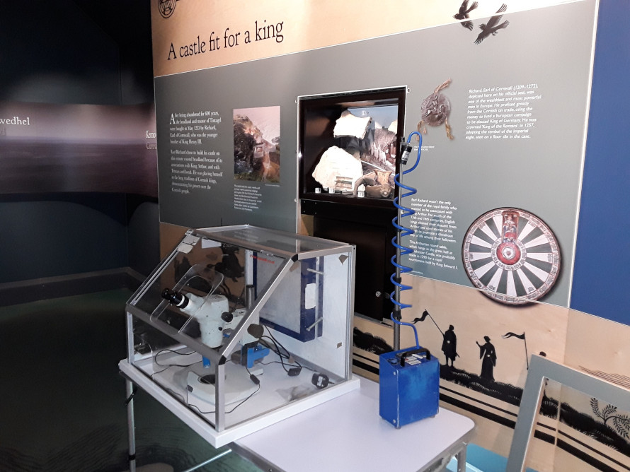 Display at Tintagel Castle with microscope