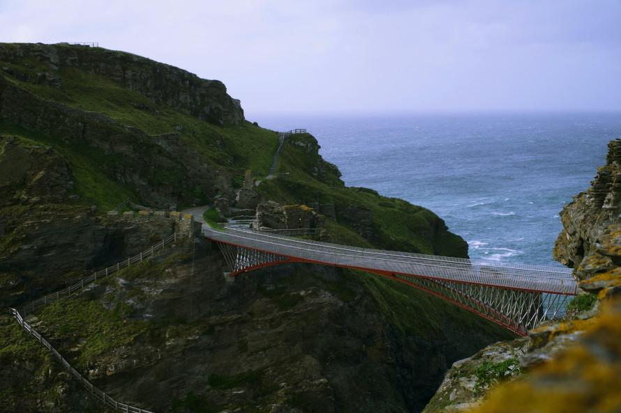 Tintagel castle foot bridge with sea background
