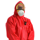 Asbestos removal operative in mask