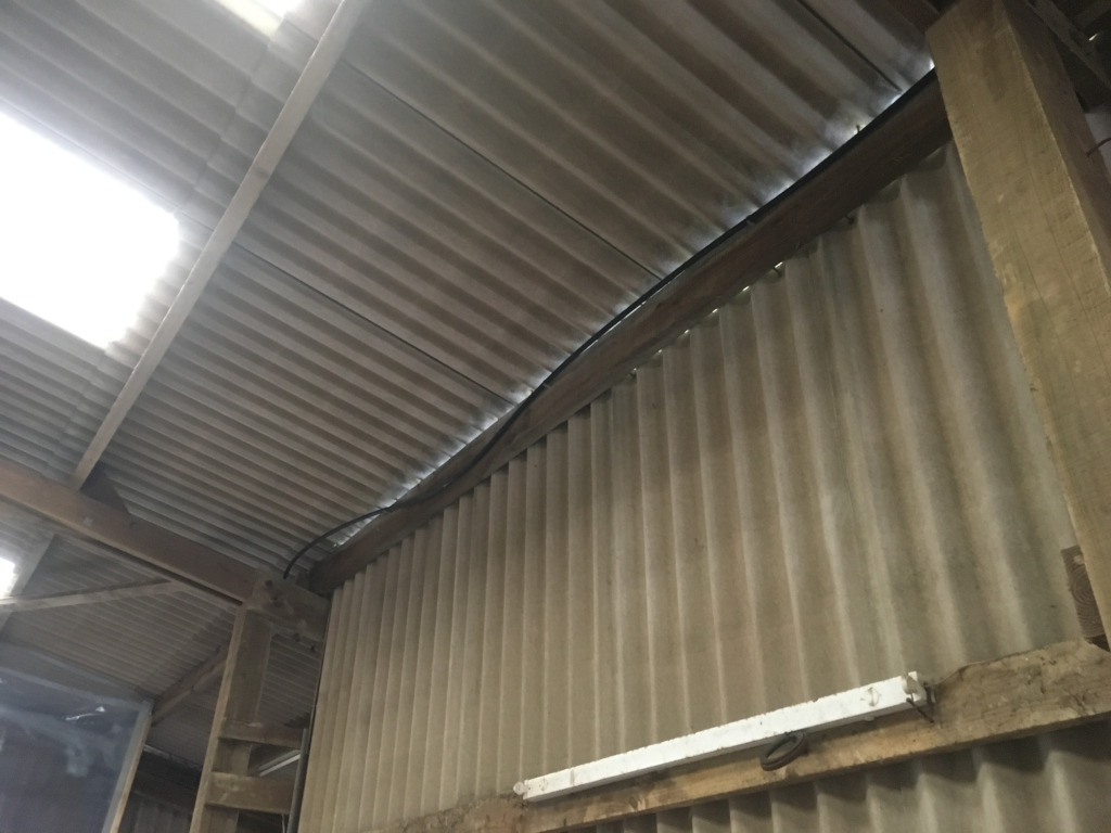 Asbestos cement profiled sheets