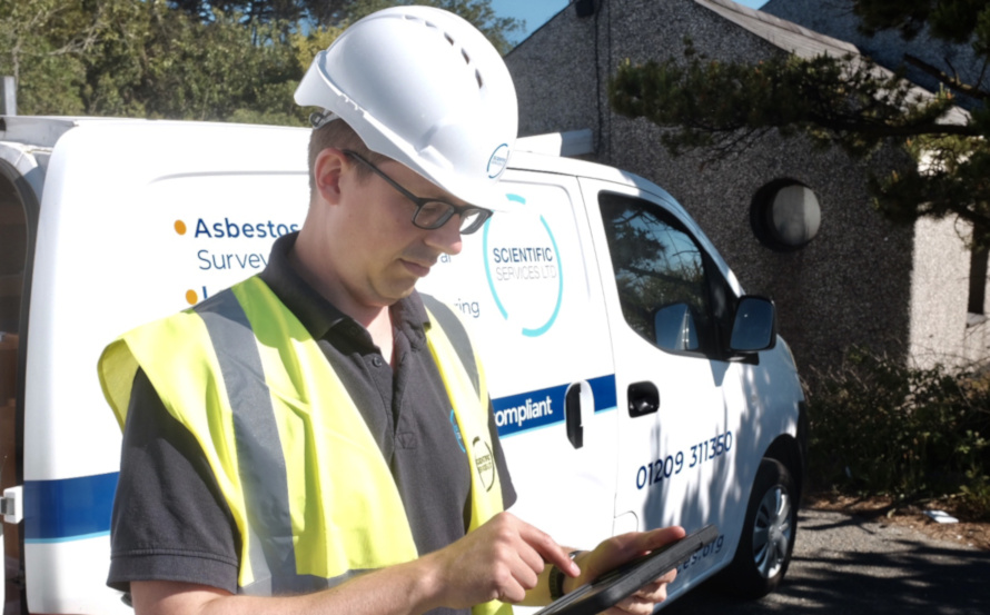 Consultant reviewing an asbestos awareness training course on a tablet