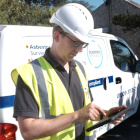 Legionella consultant with tablet and van