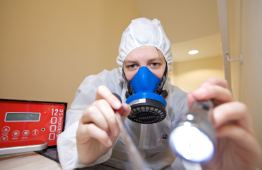 Asbestos analyst completing asbestos test