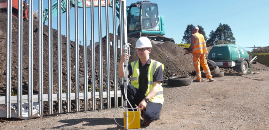Consultant setting up an asbestos air test at a building site