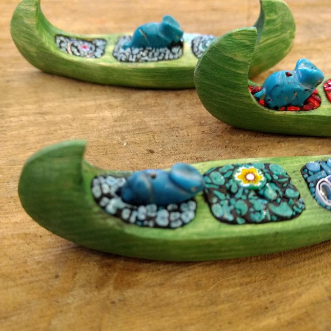 Photo of Tiny hand-carved canoes