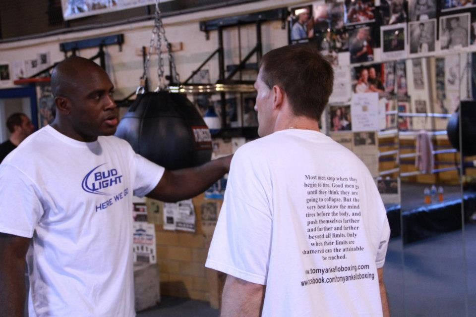 Discussing boxing strategy with coach