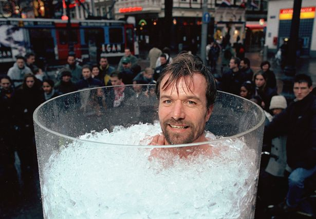 Wim Hof taking an ice bath in front of a crowd of people
