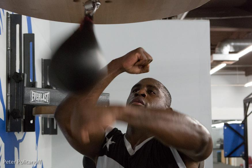 Me hitting the speedbag in the boxing gym